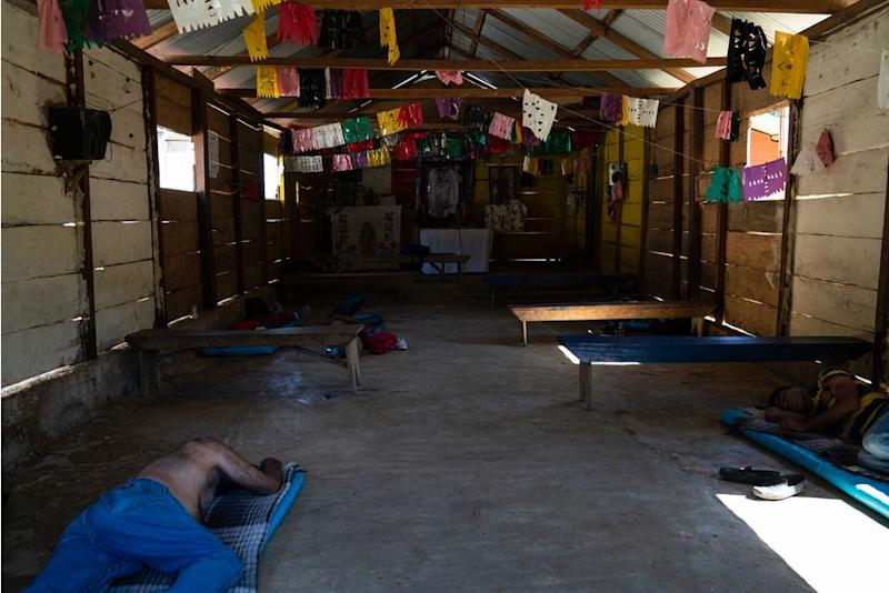 Honduran migrants Juan Ramón Andino, 60, left and José, 40, right, sleep in a church that also serves as a migrant shelter in General Emiliano Zapata del Valle near Palenque, Chiapas, on Oct. 24. The shelter is located along highway 307, known as