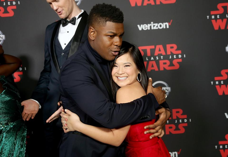 John Boyega and Kelly Marie Tran embrace on the carpet. (Photo: Jesse Grant/Getty Images for Disney)