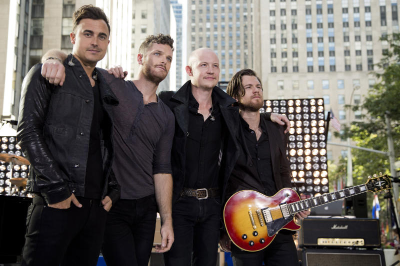 """FILE - This Aug. 13, 2012 file photo shows members of The Fray, from left, Joe King, from left, Ben Wysocki, Isaac Slade and Dave Welsh on NBC's """"Today"""" show in New York. After listening to """"Need a Girl By Friday,"""" King said that U2 frontman Bono told him in an email: """"I need a song like this every Friday."""" """"It's just encouraging to get that kind of response from people you respect and look up to,"""" King said. His relationship with the band started a few years ago when The Fray opened up for U2 during their last tou (Photo by Charles Sykes/Invision/AP, file)"""