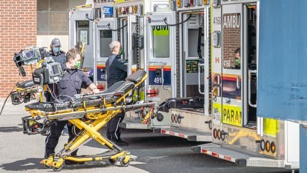 Paramedics work at The Ottawa Hospital's Civic campus on April 12, 2021. Ottawa's tally of COVID-19 hospitalizations topped 100 on Friday for the first time since the start of the pandemic. (Brian Morris/CBC - image credit)