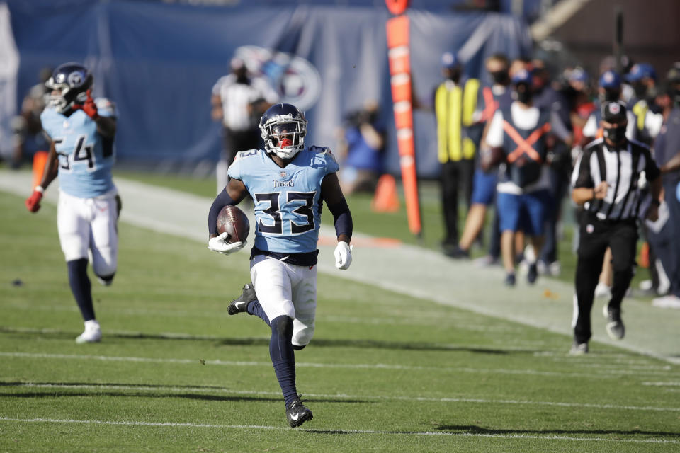 Tennessee Titans cornerback Desmond King (33) returns a fumble recovery 63 yards for a touchdown against the Chicago Bears in the second half of an NFL football game Sunday, Nov. 8, 2020, in Nashville, Tenn. (AP Photo/Ben Margot)