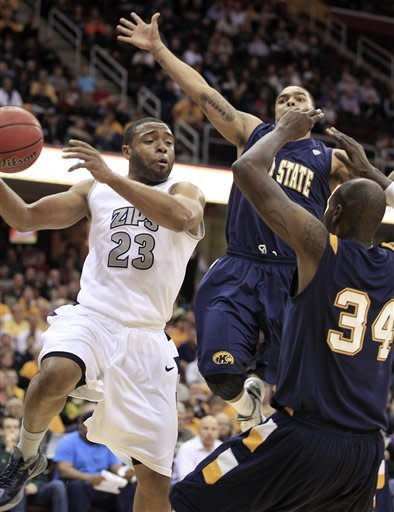 Akron's Chauncey Gilliam (23) looks for help under pressure from Kent State's Justin Greene (34) and Michael Porrini during the first half of an NCAA college basketball game in the Mid-American Conference tournament semifinals Friday, March 9, 2012, in Cleveland. (AP Photo/Tony Dejak)