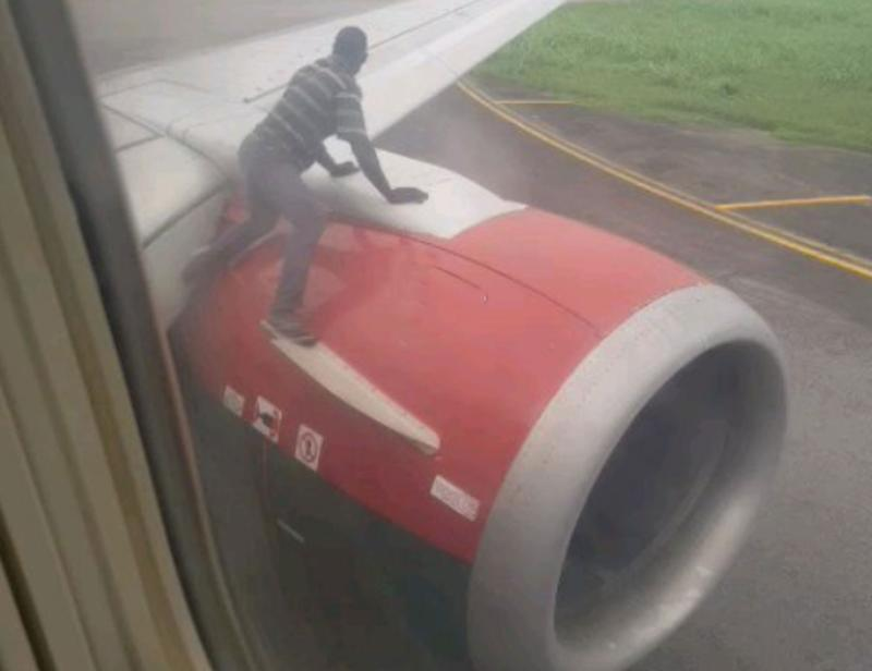 A man climbs the wing of a passenger plane in Lagos, Nigeria.