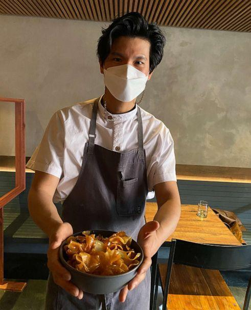 PHOTO: Chef Brian Kim holds a plate of Oiji's Honey Butter Chips with ice cream. (Oiji)