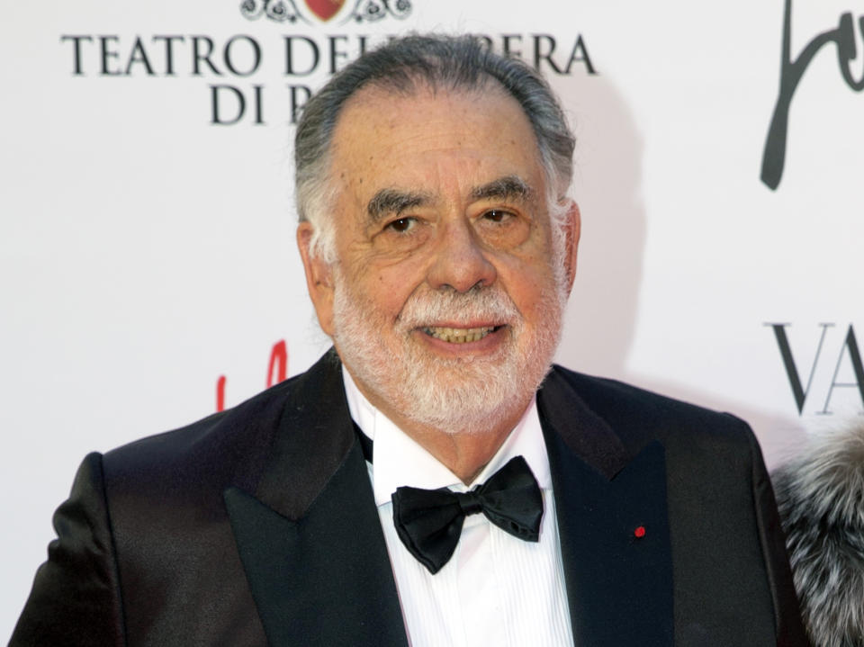 """FILE - In this May 22, 2016 file photo, director Francis Ford Coppola poses for photographers as he arrives for the premiere of Verdi's """"La Traviata'' at the Rome Opera House, in Rome. Coppola and the cast of """"The Godfather"""" reunited for one evening and a double feature at Radio City Music Hall to celebrate the film's 45th anniversary. The Tribeca Film Festival closed out its 16th edition Saturday, April 29, 2017, with a grand double feature of """"The Godfather,"""" parts one and two. (AP Photo/Andrew Medichini, File)"""