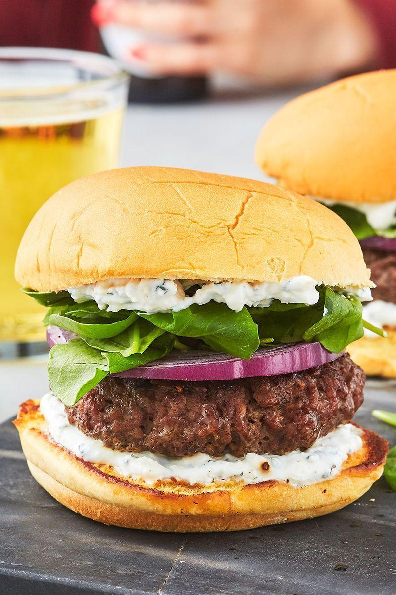 """<p>Sure, <a href=""""https://www.delish.com/uk/cooking/recipes/a30609659/big-mac/"""" rel=""""nofollow noopener"""" target=""""_blank"""" data-ylk=""""slk:cheeseburgers"""" class=""""link rapid-noclick-resp"""">cheeseburgers</a> are delicious. Sometimes though, we like to switch it up. These <a href=""""https://www.delish.com/uk/cooking/recipes/a28839760/best-greek-salad-recipe/"""" rel=""""nofollow noopener"""" target=""""_blank"""" data-ylk=""""slk:Greek"""" class=""""link rapid-noclick-resp"""">Greek</a>(ish) lamb <a href=""""https://www.delish.com/uk/cooking/recipes/g30993382/best-burger-recipes/"""" rel=""""nofollow noopener"""" target=""""_blank"""" data-ylk=""""slk:burgers"""" class=""""link rapid-noclick-resp"""">burgers</a> are full of flavour and a cinch to make! We're particularly fond of the of the feta yogurt sauce, similar to tzatziki sauce, so we slather it on both sides of the bun. If you end up with anything left over, it's a perfect dip for raw veggies or pita chips. These will make you rethink making the same old <a href=""""https://www.delish.com/uk/cooking/recipes/a28924339/best-burger-recipe/"""" rel=""""nofollow noopener"""" target=""""_blank"""" data-ylk=""""slk:hamburger"""" class=""""link rapid-noclick-resp"""">hamburger</a> ever again! </p><p>Get the <a href=""""https://www.delish.com/uk/cooking/recipes/a32152559/lamb-burger-recipe/"""" rel=""""nofollow noopener"""" target=""""_blank"""" data-ylk=""""slk:Lamb Burger"""" class=""""link rapid-noclick-resp"""">Lamb Burger</a> recipe,</p>"""