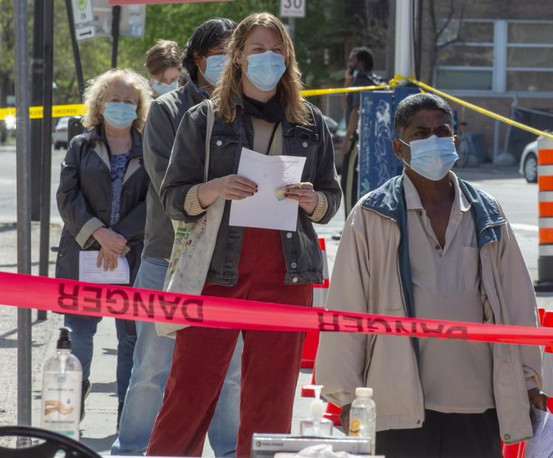 People line up at a mobile COVID-19 testing clinic, Tuesday, May 19, 2020 in Montreal. (Ryan Remiorz/The Canadian Press via AP)