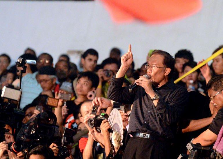 "Malaysian opposition leader Anwar Ibrahim (R) speaks during a rally at a stadium in Kelana Jaya, Selangor on May 8, 2013. Anwar called Malaysia's recent elections ""the mother of all frauds"" as he kept up the pressure over polls he says were stolen by the 56-year-old regime"