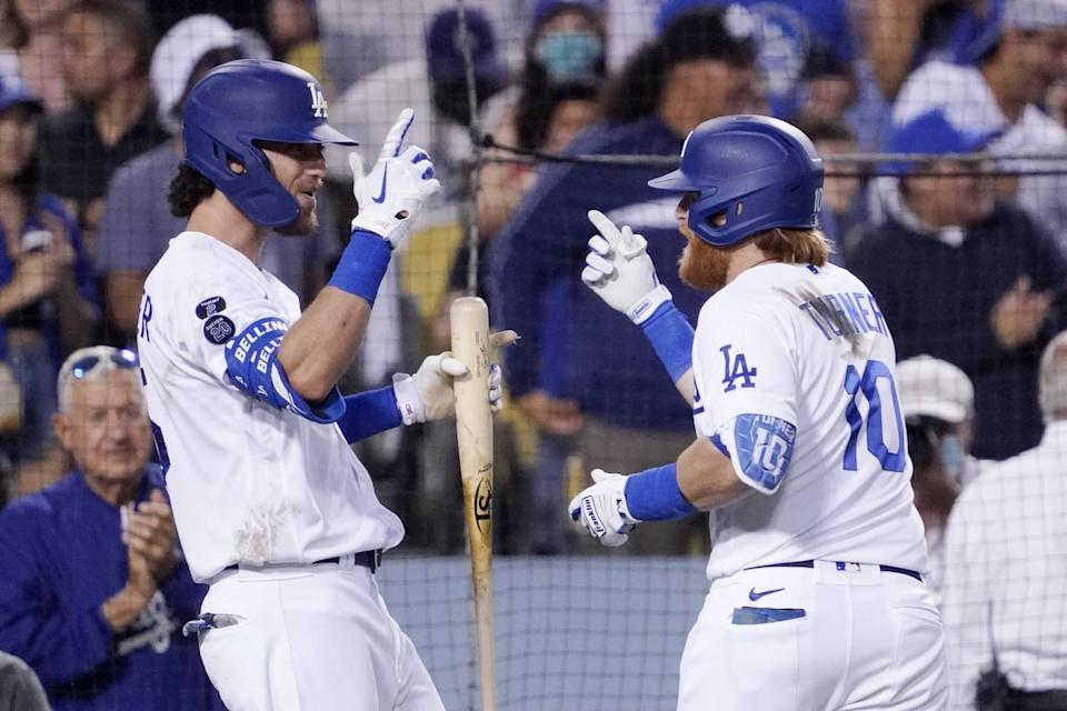 The Dodgers' Justin Turner, right, celebrates his home run with Cody Bellinger during the third inning.