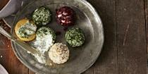"""<p>Take your cheese plate up a notch with this delicious trio, which includes a savory dill cheese ball, an """"everything bagel"""" cheese ball, and a spiced cranberry cheese ball. </p><p><em><a href=""""https://www.goodhousekeeping.com/food-recipes/easy/a35164/trio-of-cheese-balls/"""" rel=""""nofollow noopener"""" target=""""_blank"""" data-ylk=""""slk:Get the recipe for Trio Cheese Balls »"""" class=""""link rapid-noclick-resp"""">Get the recipe for Trio Cheese Balls »</a></em></p>"""