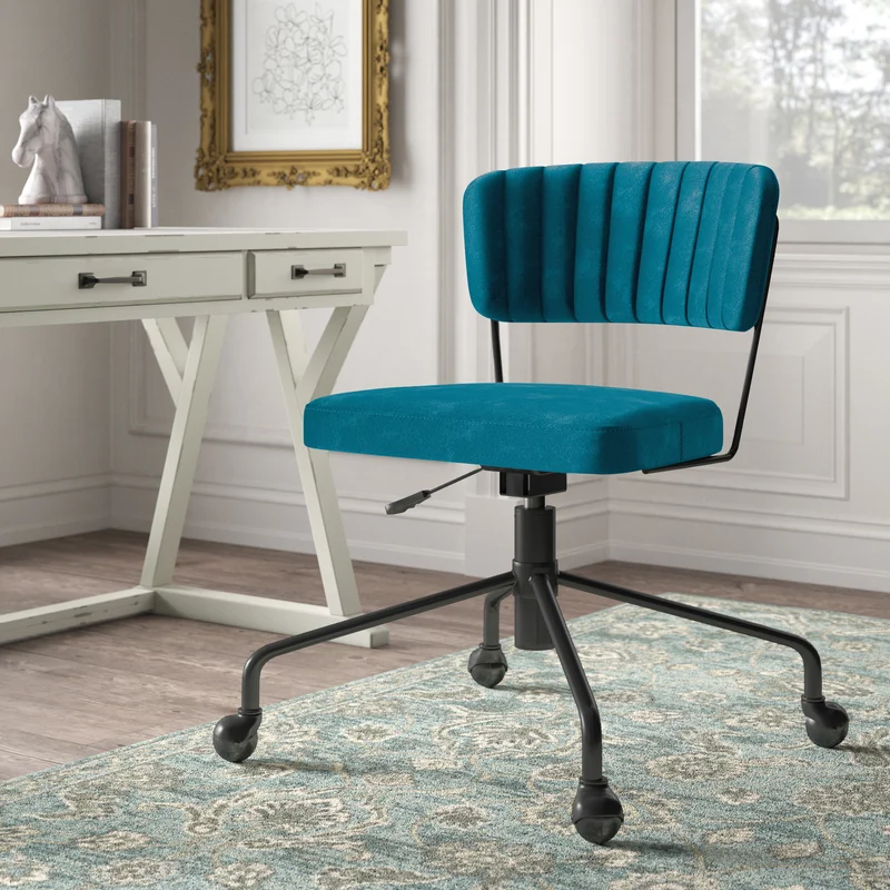 """<h3>Danielburnham Task Chair</h3><br><strong>Best For: A Simple Statement</strong><br>This compact and statement-making teal number is covered in sleek velvet, features channel tufting, and an adjustable swivel seat. <br><br><strong>The Hype: </strong>4.7 out of 5 stars and 43 reviews on <a href=""""https://www.wayfair.com/furniture/pdp/kelly-clarkson-home-danielburnham-task-chair-w003316298.html"""" rel=""""nofollow noopener"""" target=""""_blank"""" data-ylk=""""slk:Wayfair"""" class=""""link rapid-noclick-resp"""">Wayfair</a><br><br><strong>Comfy Butts Say:</strong> """"This chair is EVERYTHING I wanted and more! Stylish, minimal, and extremely comfortable. Assembly took less than 20 mins. BUY THIS YOU WON'T BE DISAPPOINTED! :)""""<br><br><strong>Kelly Clarkson Home</strong> Danielburnham Task Chair, $, available at <a href=""""https://go.skimresources.com/?id=30283X879131&url=https%3A%2F%2Fwww.wayfair.com%2Ffurniture%2Fpdp%2Fkelly-clarkson-home-danielburnham-task-chair-w003316298.html"""" rel=""""nofollow noopener"""" target=""""_blank"""" data-ylk=""""slk:Wayfair"""" class=""""link rapid-noclick-resp"""">Wayfair</a>"""