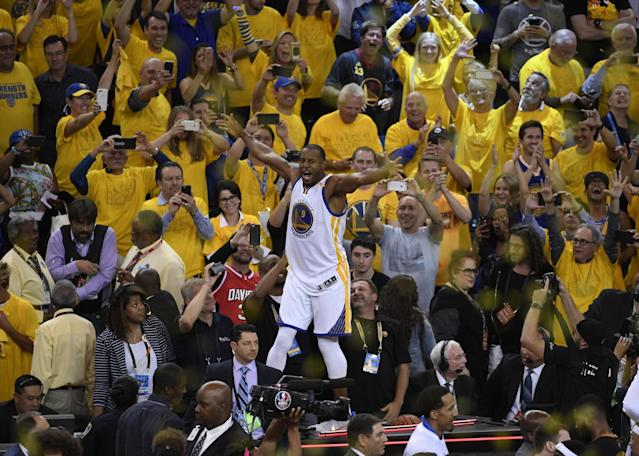 <p>Golden State Warriors forward Andre Iguodala (9) celebrates with fans in the stands after defeating the Cleveland Cavaliers in game five of the 2017 NBA Finals at Oracle Arena. Mandatory Credit: Kyle Terada-USA TODAY Sports </p>