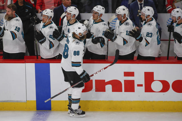 San Jose Sharks defenseman Brent Burns (88) celebrates with teammates after scoring against the Chicago Blackhawks during the second period of an NHL hockey game Thursday, Oct. 10, 2019, in Chicago. (AP Photo/Kamil Krzaczynski)