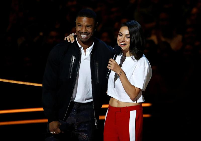 Michael B. Jordan and Mila Kunis speak on stage at the awards (REUTERS)