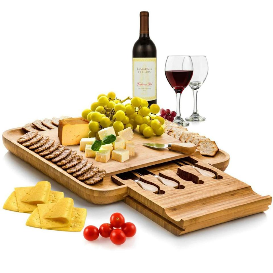 """<h2>Bambusi Cheese Board and Knife Set</h2><br>The ultimate board plate, for an affordable price. What's not to love? <br><br><strong><em><a href=""""https://www.amazon.com/stores/Bamb%C3%BCsi/page/96587DC0-03F2-4602-A3F2-E3C527155E41?ref_=ast_bln"""" rel=""""nofollow noopener"""" target=""""_blank"""" data-ylk=""""slk:Shop Amazon"""" class=""""link rapid-noclick-resp"""">Shop Amazon</a></em></strong> <br><br><strong>Bambüsi</strong> Bambusi Cheese Board and Knife Set, $, available at <a href=""""https://amzn.to/31KaZ7F"""" rel=""""nofollow noopener"""" target=""""_blank"""" data-ylk=""""slk:Amazon"""" class=""""link rapid-noclick-resp"""">Amazon</a>"""