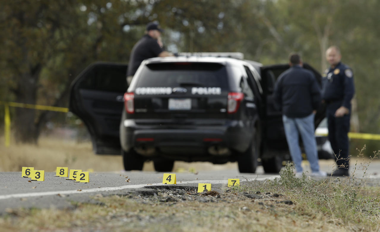 <p>Yellow tags mark where bullet casings found at one of the scenes of a shooting spree at Rancho Tehama Reserve, near Corning, Calif., Nov. 14, 2017. (Photo: Rich Pedroncelli/AP) </p>