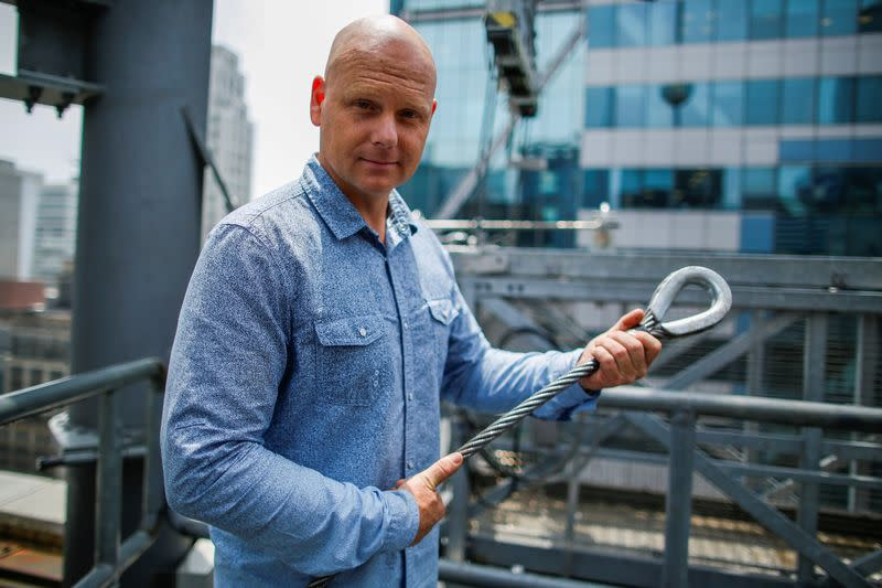 FILE PHOTO: Aerialist Wallenda holds a sample of a wire while he speaks with media as he prepares for a highwire walk over Times Square in New York