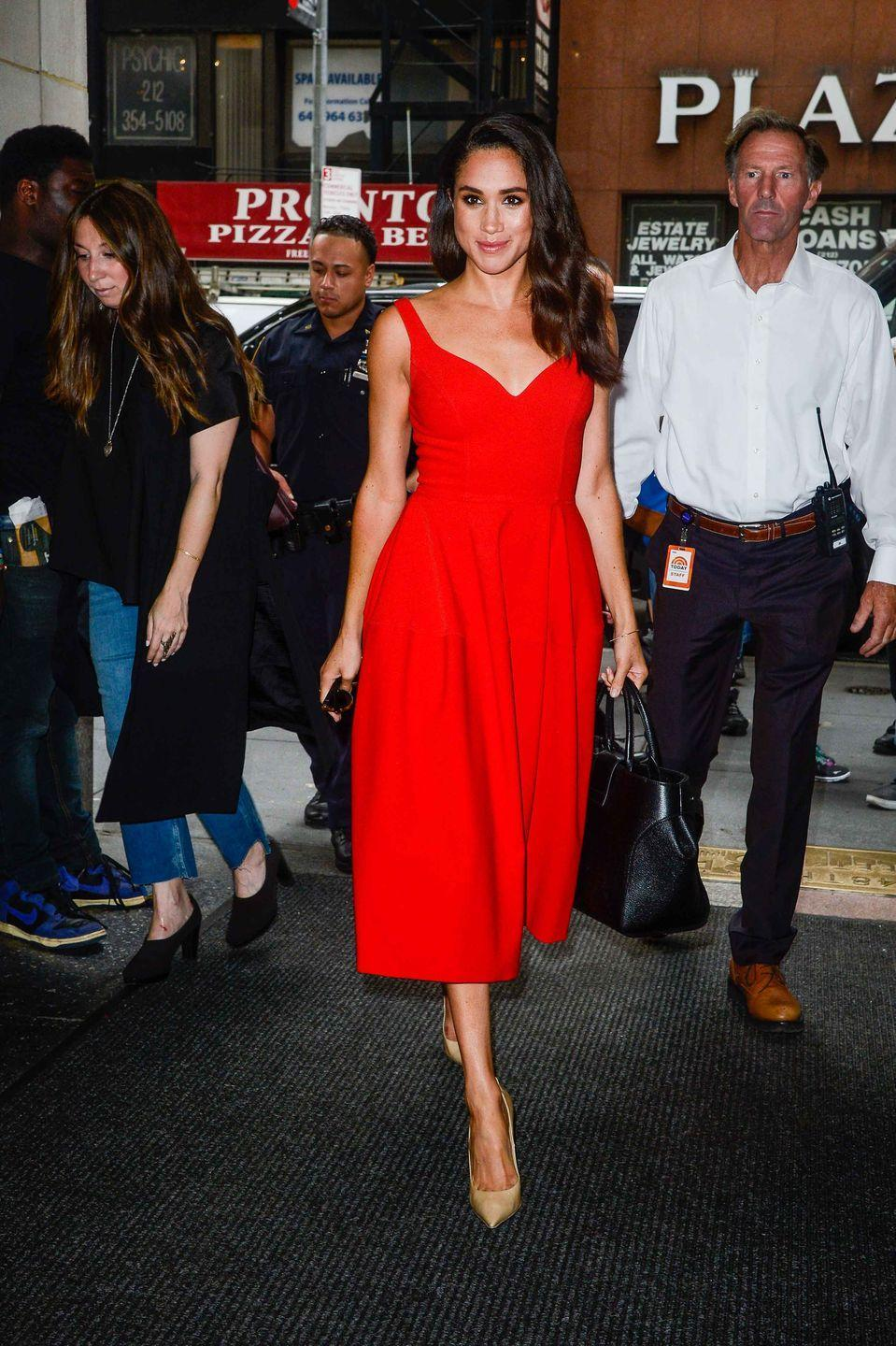 <p>Here, she steps out in a red tea-length dress and nude heels for an appearance on the <em>Today Show </em>at NBC Rockefeller Center Studios in New York City.</p>