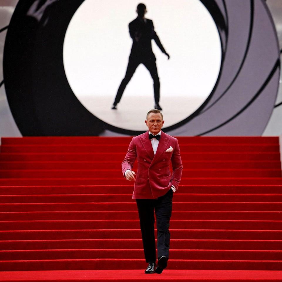 Daniel Craig poses for photographers upon arrival