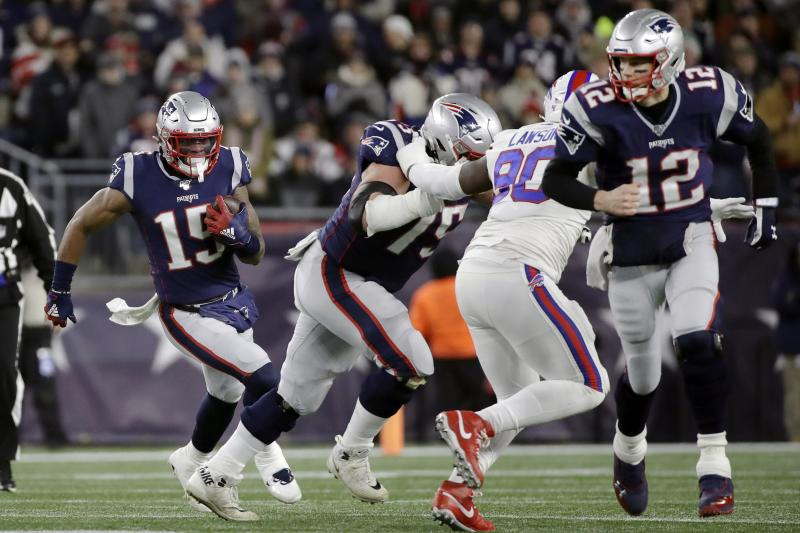 New England Patriots wide receiver N'Keal Harry, left, runs with the ball as quarterback Tom Brady, right, runs ahead to block in the first half of an NFL football game against the Buffalo Bills, Saturday, Dec. 21, 2019, in Foxborough, Mass. (AP Photo/Elise Amendola)