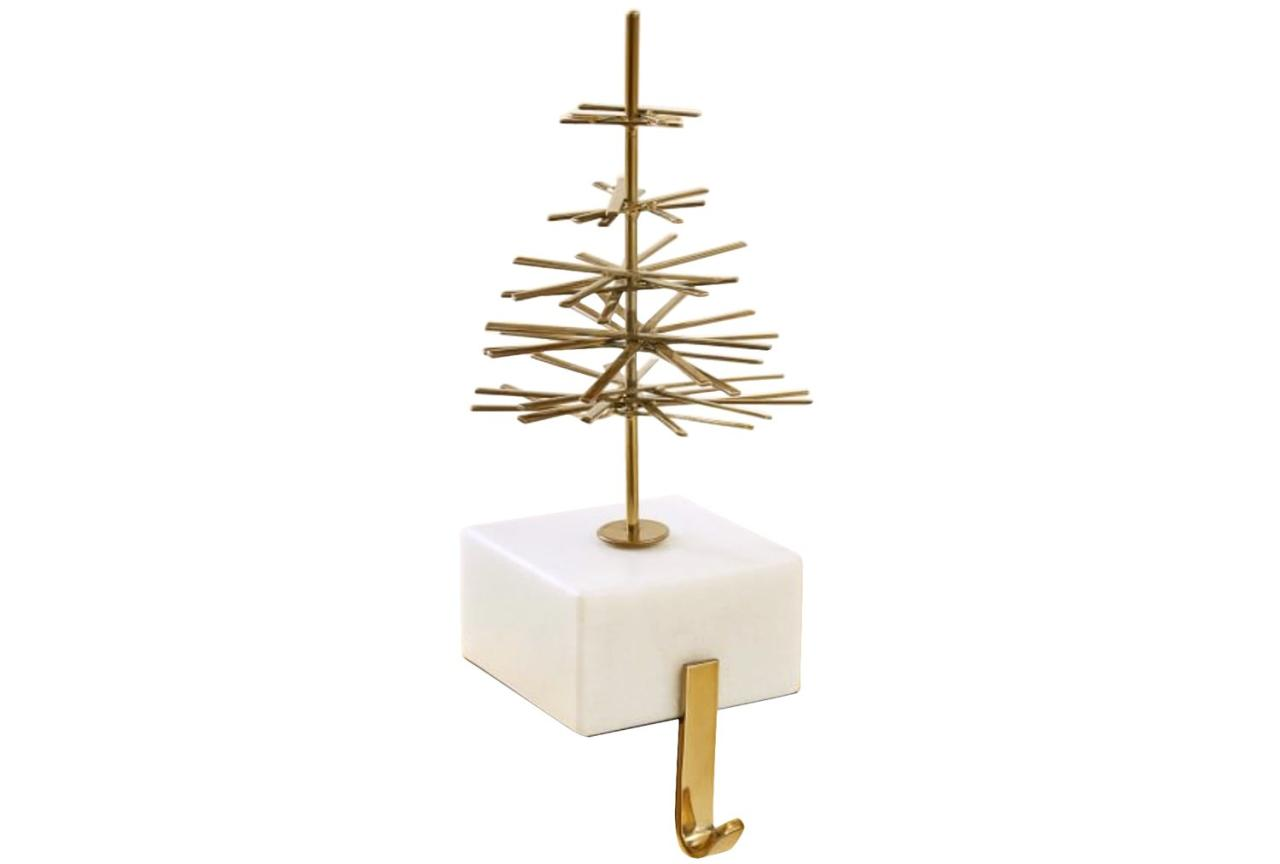 """<p>Decorations don't need to be red and green to pack Christmas spirit. Marble and gold are a classic combination and the simple tree on top of this holder feels modern and chic. </p> <p><strong>To buy:</strong> $29; <a href=""""http://westelm.7eer.net/c/249354/267856/4336?subId1=RS%2CThe30BestChristmasStockingHoldersof2017%2Cdarganb%2CCHR%2CGAL%2C571654%2C201711%2CI&u=https%3A%2F%2Fwww.westelm.com%2Fproducts%2Fmodern-marble-brass-stocking-holder-d4826%2F%3Fpkey%3Dcchristmas-stockings-decor"""" target=""""_blank"""">westelm.com</a>.</p>"""