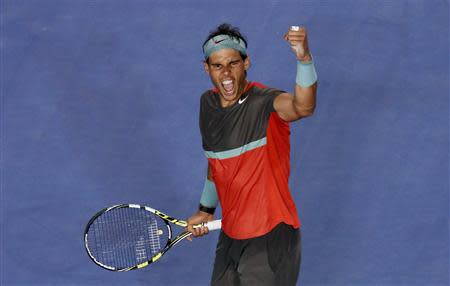 Rafael Nadal of Spain celebrates defeating Roger Federer of Switzerland in their men's singles semi-final match at the Australian Open 2014 tennis tournament in Melbourne January 24, 2014. REUTERS/David Gray
