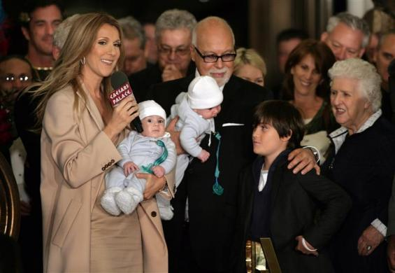 Celine Dion speaks to employees, reporters and fans as she arrives at Caesars Palace with her husband and sons in Las Vegas, February 16, 2011.