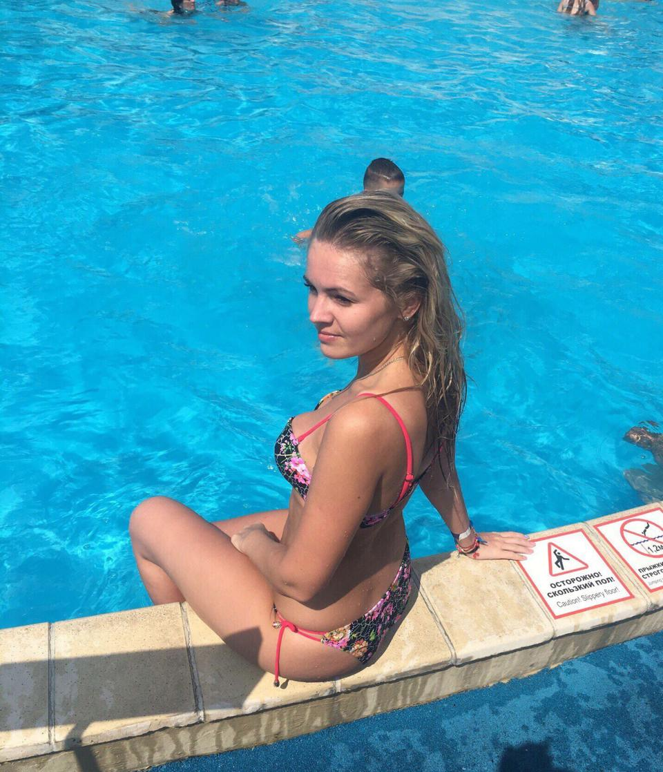 Evgenia Shulyatyeva poses for a photo next to a swimming pool. Her mother found her dead after she failed to answer her phone.