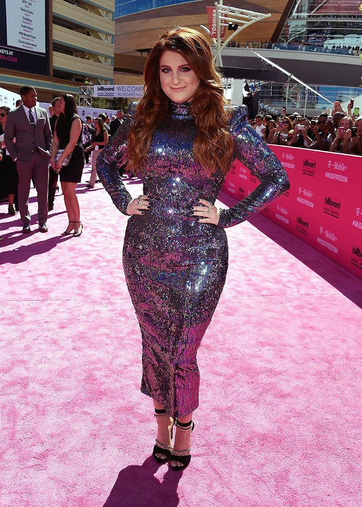 """<p>Performer Trainor (she's set to sing her retro-vibe hit """"No"""") stuck with what's been working for her lately — a sequined curve-hugging gown that's seriously <i>Star Trek</i> with structured shoulders and a high neck. <i>(Photo: Frazer Harrison/Getty Images)</i></p>"""