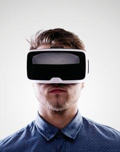 """<span class=""""caption"""">Live-action VR is helpful as a therapeutic tool for victims and perpetrators.</span> <span class=""""attribution""""><a class=""""link rapid-noclick-resp"""" href=""""https://www.shutterstock.com/image-photo/man-wearing-virtual-reality-goggles-studio-394698058"""" rel=""""nofollow noopener"""" target=""""_blank"""" data-ylk=""""slk:Shutterstock"""">Shutterstock</a></span>"""
