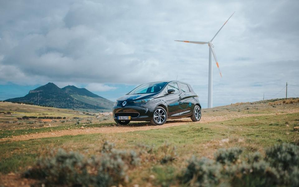 Renault Zoe on Porto Santo with the island's wind turbines in the background