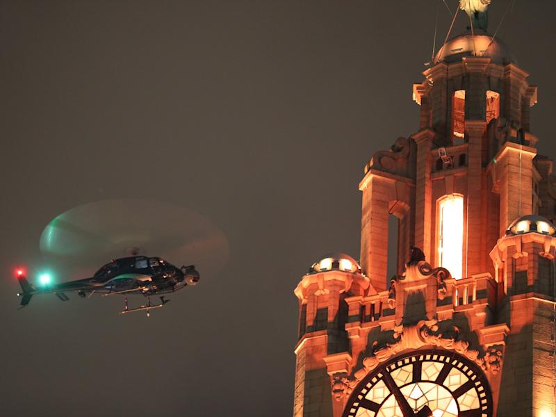 Helicopters circled the city's Liver Building as stunts are filmedPA