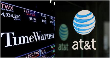 FILE PHOTO: FILE PHOTO: A combination photo of the Time Warner shares price at the New York Stock Exchange and AT&T logo in New York
