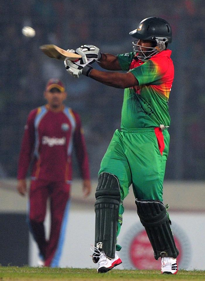 Bangladesh batsman Tamim Iqbal plays a shot during the fourth one day international cricket match between Bangladesh and the West Indies at The Sher-e-Bangla National Cricket Stadium in Dhaka on December 7, 2012. AFP PHOTO/ Munir uz ZAMAN