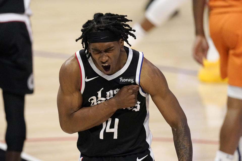 Los Angeles Clippers guard Terance Mann celebrates after scoring during the second half in Game 3 of the NBA basketball Western Conference Finals against the Phoenix Suns Thursday, June 24, 2021, in Los Angeles. (AP Photo/Mark J. Terrill)