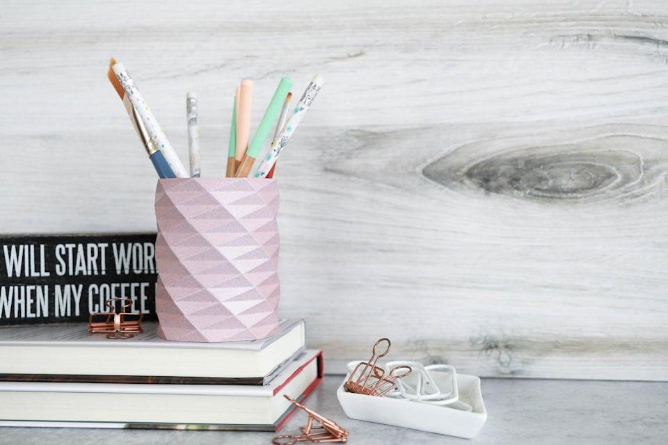 <p>Complete with a sparkly finish, this <span>Geometric Pencil Holder</span> ($12) is too cute.</p>