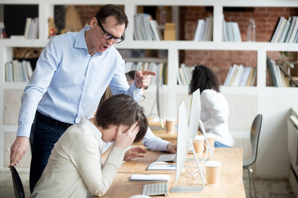 Furious businessman shout at female employee working in shared office, mad male boss scream at guilty intern, blaming for mistake, CEO accuse woman worker in company failure or bad results
