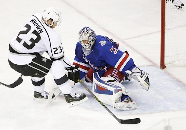 Los Angeles Kings right wing Dustin Brown (23) moves to score on New York Rangers goalie Henrik Lundqvist (30) in the second period during Game 4 of the NHL hockey Stanley Cup Final, Wednesday, June 11, 2014, in New York. (AP Photo/Frank Franklin II)