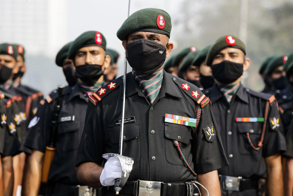 Indian army soldiers wearing face mask to prevent the spread of the coronavirus march during rehearsals of Republic Day parade in Kolkata, India, Friday, Jan. 22, 2021. (AP Photo/Bikas Das)