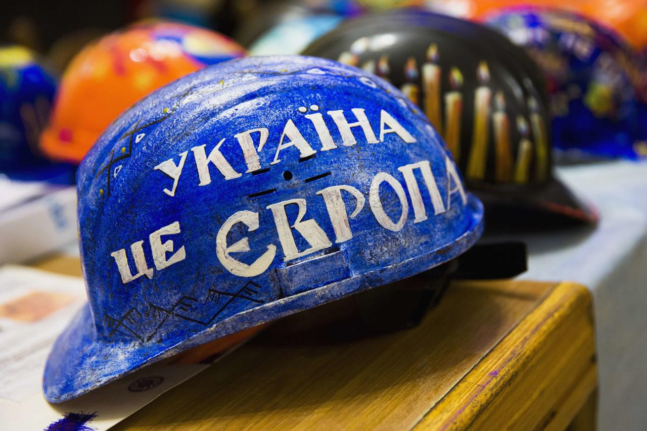 """REFILE - CORRECTING SPELLING OF """"MOTIFS""""  A hardhat for an anti-government protester painted with the words 'Ukraine is Europe', is seen on display at the Kiev City Hall, which has been occupied by opposition forces, February 1, 2014. Anatoly Kravets, the coordinator of an impromptu art project asking protesters to adorn the hardhats they used to protect themselves during street battles with riot police, said the variety of motifs reflect the diversity of Ukrainians who have joined on the movement around Kiev's Independence Square. """"Those helmets have become the symbol of our revolution, they are the symbol of the peaceful coming together of our nation. They protect us and their colorful appearance contrasts nicely the black uniformity of police helmets,"""" he said. REUTERS/Thomas Peter (UKRAINE - Tags: POLITICS CIVIL UNREST SOCIETY TPX IMAGES OF THE DAY)"""