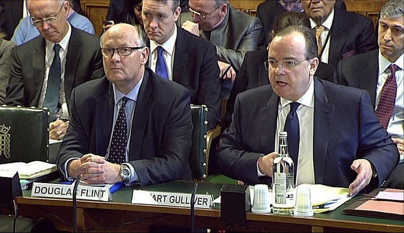 A still image from video shows HSBC Chairman Douglas Flint and HSBC Chief Executive Stuart Gulliver appearing before the Treasury Select Committee at parliament in London February 25, 2015. REUTERS/UK Parliament via REUTERS TV