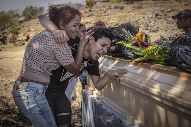 <p>Darwin mourns the death of his brother Marco at his funeral. His brother, 28, was gay and was kidnapped, tortured and killed. (Photo: Francesca Volpi) </p>