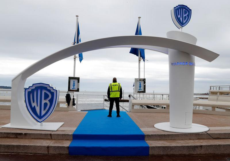 The logo of Warner Bros entertainment company is seen during the MIPTV, the International Television Programs Market, in Cannes