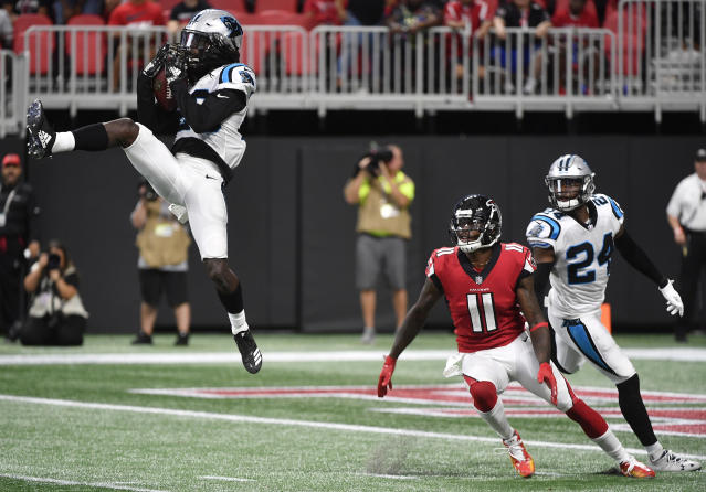 <p>Carolina Panthers cornerback Donte Jackson (26) intercepts the ball ahead of Atlanta Falcons wide receiver Julio Jones (11) during the second half of an NFL football game, Sunday, Sept. 16, 2018, in Atlanta. (AP Photo/John Amis) </p>