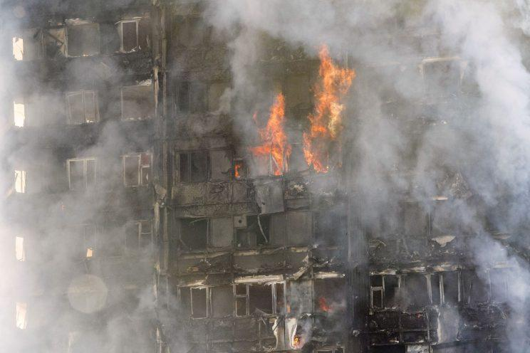 Smoke and flames rip through the building (PA Images)