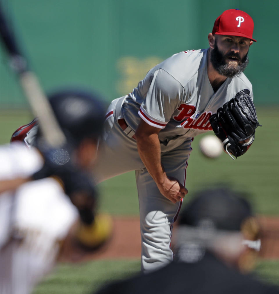 Philadelphia Phillies starting pitcher Jake Arrieta delivers in the first inning of a baseball game against the Pittsburgh Pirates in Pittsburgh, Saturday, July 7, 2018. (AP Photo/Gene J. Puskar)