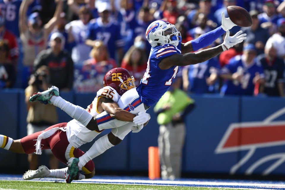 Washington Football Team's Benjamin St-Juste (25) defends Buffalo Bills' Stefon Diggs (14) during the first half of an NFL football game Sunday, Sept. 26, 2021, in Orchard Park, N.Y. The pass was incomplete. (AP Photo/Adrian Kraus)