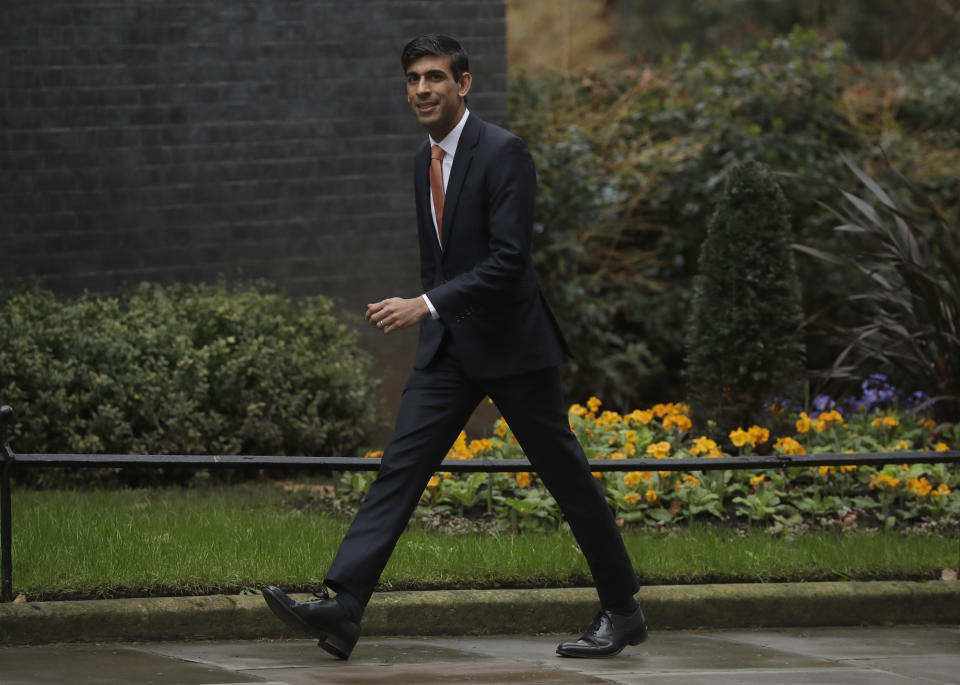 British lawmaker Rishi Sunak, Chief Secretary to the Treasury, Chief Secretary to the Treasury arrives at 10 Downing Street in London, Thursday, Feb. 13, 2020. British Prime Minister Boris Johnson shook up his government on Thursday, firing and appointing ministers to key Cabinet posts. Johnson was aiming to tighten his grip on government after winning a big parliamentary majority in December's election. That victory allowed Johnson to take Britain out of the European Union in January. (AP Photo/Matt Dunham)