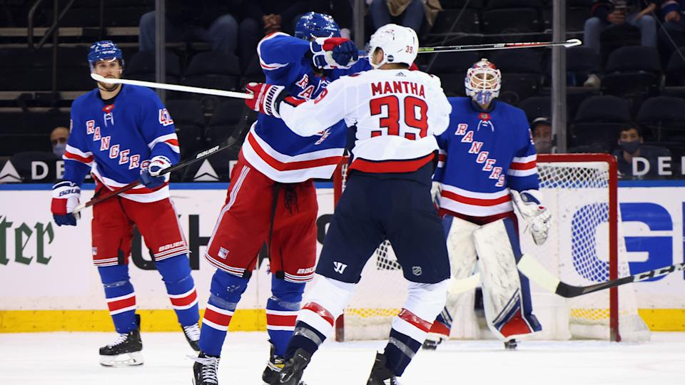 NEW YORK, NEW YORK - MAY 05: Pavel Buchnevich #89 of the New York Rangers takes a high-sticking penalty on Anthony Mantha #39 of the Washington Capitals during the second period at Madison Square Garden on May 05, 2021 in New York City. (Photo by Bruce Bennett/Getty Images)
