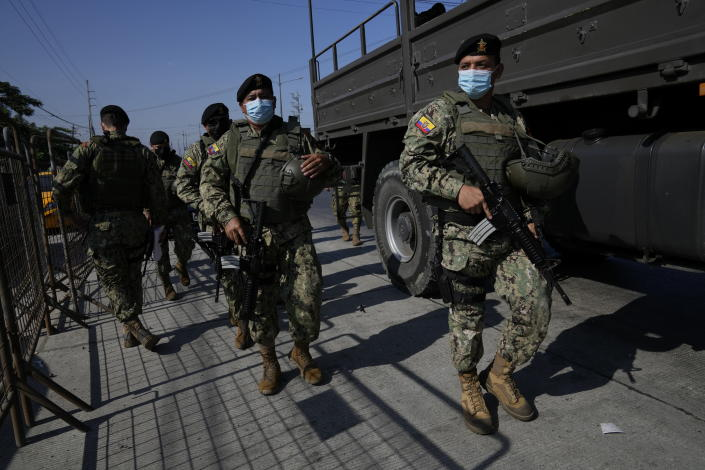 Security forces arrive to Litoral Penitentiary after deadly fights inside the jail in Guayaquil, Ecuador, Thursday, July 22, 2021. Rival gangs of inmates fought in two prisons in Ecuador, killing at least 18 people and injuring dozens, authorities said Thursday. (AP Photo/Dolores Ochoa)